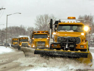 Four snowplows lined up